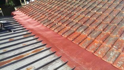 Tiles to metal roof